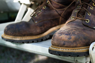 A pair of well used  leather work boots.