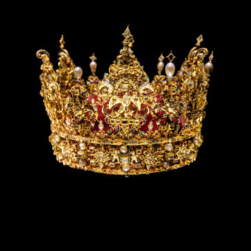 Golden crown with gems isolated on black background