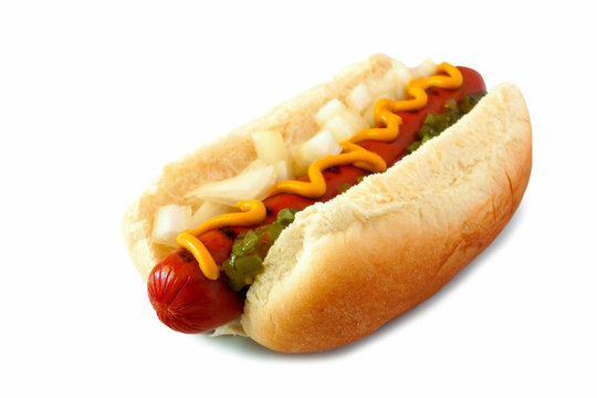 Hot dog with mustard, onions and relish, side view isolated on a white background