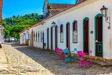 Fotomurales - Street with tables of cafe in historical center in Paraty, Rio de Janeiro, Brazil. Paraty is a preserved Portuguese colonial and Brazilian Imperial municipality