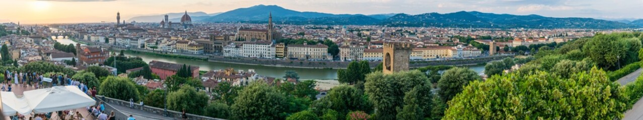 Long panoramic view of Florence from Piazzale Michelangelo.  Cityscape panorama with the Arno river, basilica, cathedral, Palazzo Vecchio