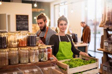 Couple working in a bulk food store - fototapety na wymiar