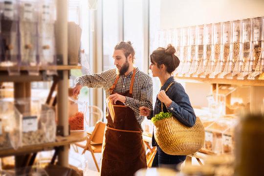 Beautiful young woman shopping in a bulk food store