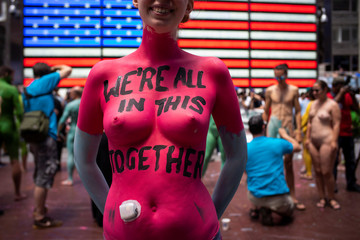 A woman who uses an insulin device takes part in a protest against divisiveness organized by Human Connection Arts at Times Square in New York