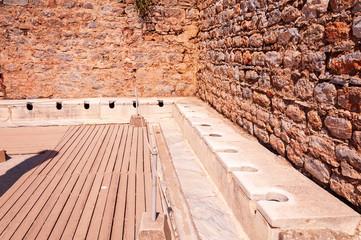 Public toilet in the ancient city of Ephesus in Izmir, Turkey.