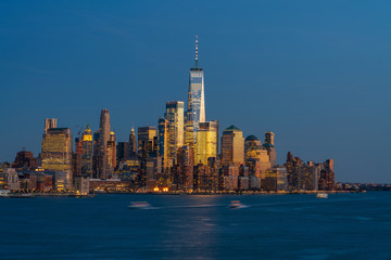 Fototapete - Lower Manhattan which is a apart of New york cityscape river side which can see One world trade center at twilight time, USA, Taking from New Jersey