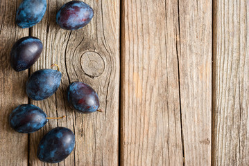 plums on old wood table directly above