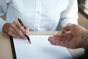 Legal counsel presents to the client a signed contract with gavel and legal law. justice and lawyer...