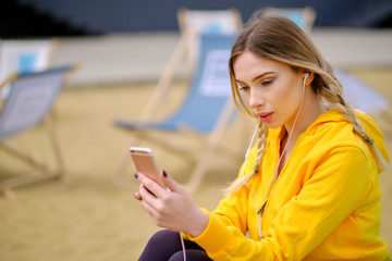 Woman listening music on her headphones