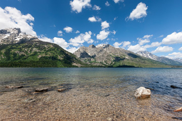 A fresh water lake in Montana with blue sky and clouds.