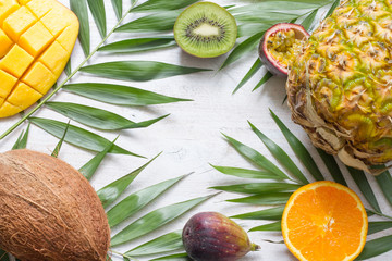 Tropical holiday summer abstract background with palms and fruits