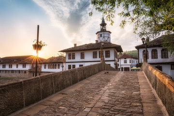 First light above the old street / Morning view with an old street in the revival architectural complex in Tryavna, Bulgaria