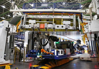 A fixed-bed robot works in a wing assembly station during a media tour of the Boeing 777X at the Boeing production facility in Everett