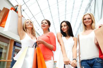 Happy girls in shopping mall