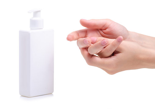 White bottle soap with dispenser in hand on white background isolation