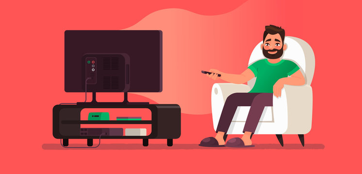 Man watches TV while sitting in a chair. View your favorite television show or movie