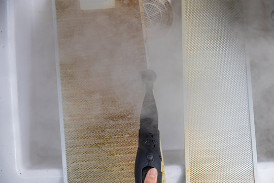 Cleaning aluminum filter for kitchen hood.