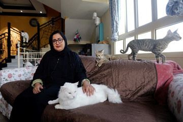 Dr. Amna Al Ahbabi who rescues stray and abandoned cats poses for a photograph during an interview at her home in Al Ain city