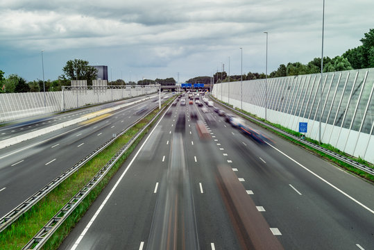 Traffic over the highway, motion blurred traffic, ring east A10, 06/14/2019 Amsterdam the Netherlands, speedway, freeway fast
