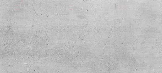 Graue Betonmauer, Grauer Hintergrund, Grau Struktur mit groben und zerkratzen Stzrukturen im Indiustrial Design. Graue Steinmauer als Hintergrund und gestalterisches Element.