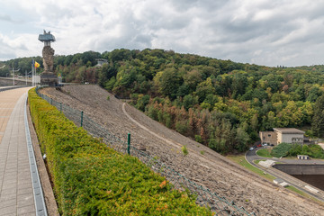 Gileppe dam in Belgium with footpath, watch-tower and monumental Lion