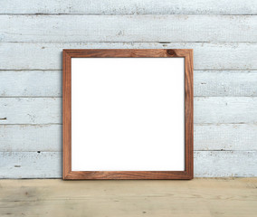 Square Old Wooden Frame mockup  stands on a wooden table on a painted white wooden background. Rustic style, simple beauty. 3d render.