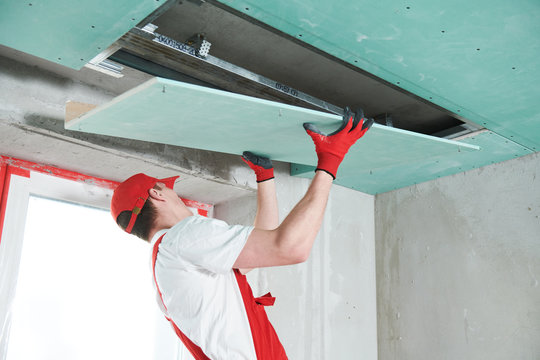 gypsum plasterboard construction work at suspended ceiling
