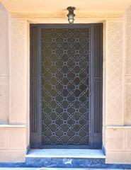 elegant 60's house entrance metallic grey door
