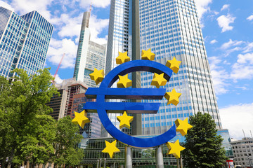 Business and finance concept with giant Euro sign at European Central Bank headquarters in the morning, business district in Frankfurt am Main, Germany