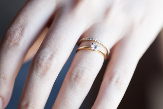 Close up view of woman's hand with wedding ring in sun light