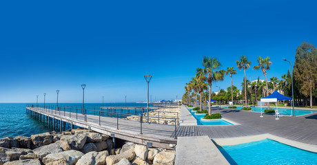 Limassol. Republic of Cyprus sea embankment panorama, Molos Limassol quay. Pedestrian pier leads to the sea. Mediterranean beach landscape. The beaches in Cyprus. Travelling to Cyprus. Fototapete
