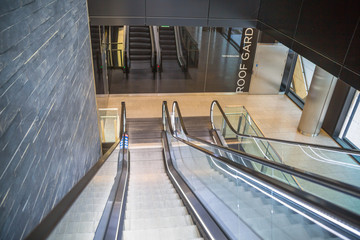 Escalators in an train station. Empty escalator stairs. Modern escalator in public building, shopping mall, Department store. Empty, no people