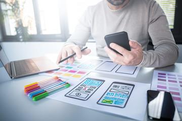 Designers man drawing website ux app development.
