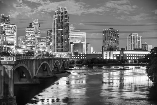 urban skyline along the river at night