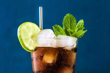 Coca Coke cocktail in a tall glass cuba libre. refreshing summer drink Wall mural