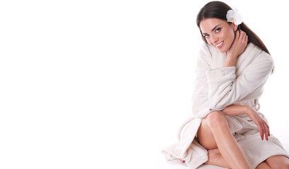Healthy look of model sitting in white bathrobe.