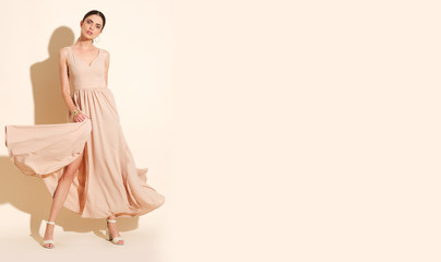A confident model in long dress looks just fabulous!