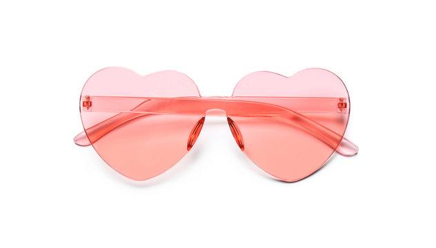 Stylish heart shaped glasses on white background