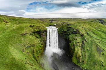 Deurstickers Watervallen Iceland waterfall Skogafoss in Icelandic nature landscape. Famous tourist attractions and landmarks destination in Icelandic nature landscape on South Iceland. Aerial drone view of top waterfall.