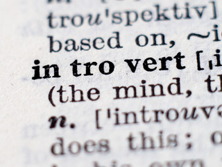 Dictionary definition of word introvert. Selective focus.