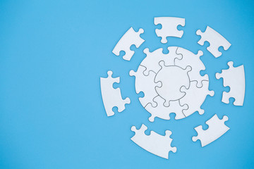 Unfinished white jigsaw puzzle pieces on blue background, The last piece of jigsaw puzzle, Copy space. Wall mural