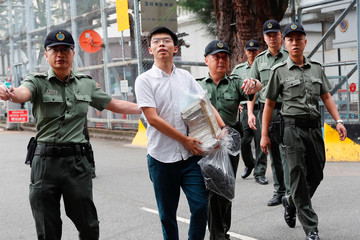 "Former student leader Joshua Wong walks out from prison after being jailed for his role in Occupy Central movement, also known as ""Umbrella Movement"", in Hong Kong"
