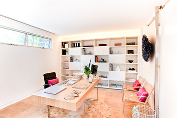 Modern office or workplace with a rack and wooden floor