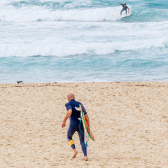 Surfers in action on Bondi Beach in Sydney, Australia