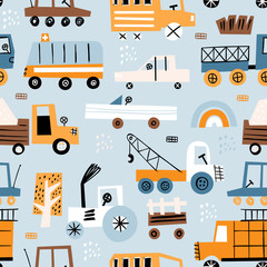 Cute seamless pattern with hand drawn toy cars. Perfect for kids fabric, textile, nursery wallpaper. Blue background.
