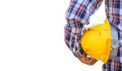 Concept construction worker on white background,construction worker holding safety yellow helmet with for the safety of the work operation,copy-space