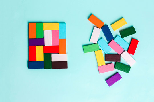 order and chaos. Chaotic unorganized colored dominoes and ordered. Concept of business model, organization. L
