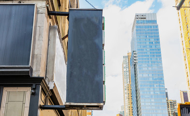 Fototapete - New York, Manhattan. Blank black sign against blur skyscraperscopy space