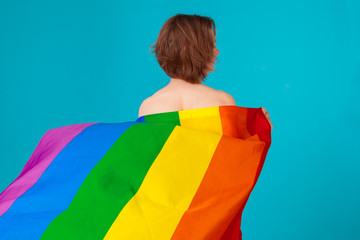 young  woman covering with lgbt pride flag