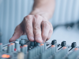 Music producer professional career. Closeup of man hand adjusting sound effects. Copy space.